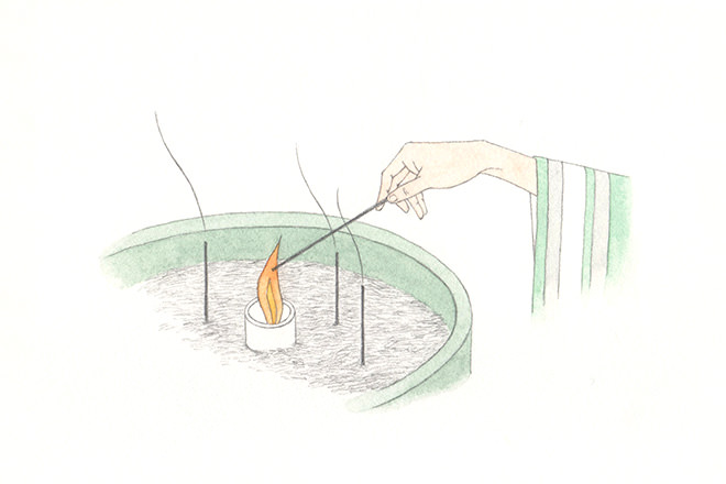 Take one stick of incense with the right hand and light it from a candle.(You may fan the fire with the left hand to put out the incense stick, but do not blow it out.)
